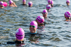 © Licensed to London News Pictures. 24/09/2016. London, UK. Participants warm up at the start of the first ever Swim Serpentine, held in the famous lake in Hyde Park.  Raising thousands for charity and with water temperatures of 18C, swimmers navigate the one mile clockwise route around the lake.  The two-day open water swimming festival includes the British Open Water Swimming Championships on Sunday. Photo credit : Stephen Chung/LNP