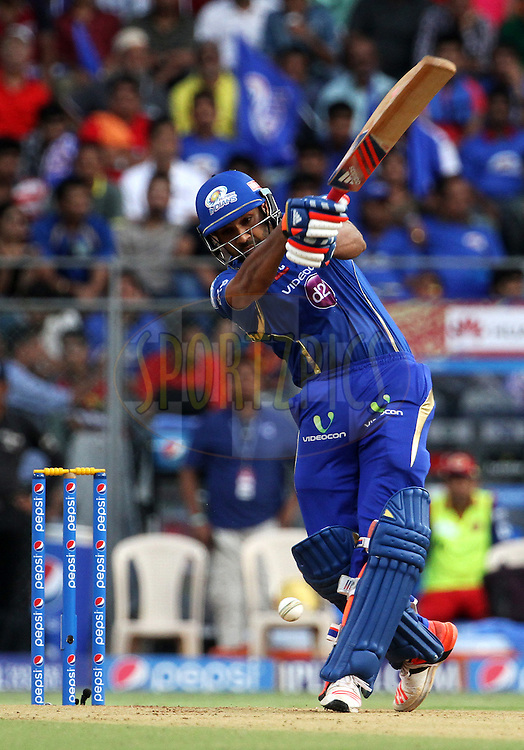 Mumbai Indians captain Rohit Sharma plays a shot during match 46 of the Pepsi IPL 2015 (Indian Premier League) between The Mumbai Indians and The Royal Challengers Bangalore held at the Wankhede Stadium in Mumbai, India on the 10th May 2015.<br /> <br /> Photo by:  Vipin Pawar / SPORTZPICS / IPL