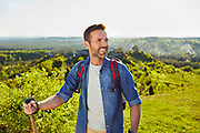 man enjoying summer hike trekking with backpack