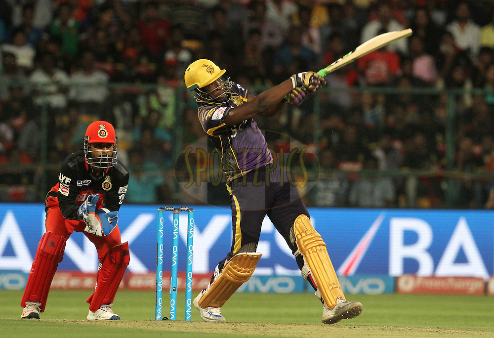 Kolkata Knight Riders player Andre Russell plays a shot during match 30 of the Vivo IPL ( Indian Premier League ) 2016 between the Royal Challengers Bangalore and the Kolkata Knight Riders  held at The M. Chinnaswamy Stadium in Bangalore, India,  on the 2nd May 2016<br /> <br /> Photo by Vipin Pawar / IPL/ SPORTZPICS