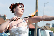 Fire Eaters entertain the crowds entering the crowds during the Scottish Grand National, Ladies day at Ayr Racecourse, Ayr, Scotland on 12 April 2019.