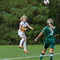 2nd year defender Cassie Longmuir (18) of the Regina Cougars goes up for a header during the Women's Soccer Homeopener on September 10 at U of R Field. Credit: Arthur Ward/Arthur Images
