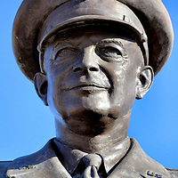 Dwight Eisenhower Gravesite Statue at Eisenhower Presidential Library in Abilene, Kansas<br /> An 11 foot statue of Dwight D. Eisenhower as a five-star general stands near his tomb at the Eisenhower Presidential Library and Museum in Abilene, Kansas. He began his military career in 1911 when he entered West Point and later graduated first in his class. He proceeded to become a five-star general as the commander-in-chief of the Allied Forces and then the first Supreme Allied Commander of NATO. Eisenhower was the 34th President from 1953 to 1961.