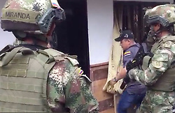 """EXCLUSIVE: *NO WEB UNTIL 11PM BST SEPT 2ND* The dramatic moment British 'drugs baron' Andrew Deamer is arrested in Colombia for allegedly smuggling cocaine worth £345 million hidden in DOG FOOD. Deamer, 52, now faces 14 years in a Colombian prison after being seized in a dramatic 6am raid on his isolated home outside Medellin - the city made infamous by infamous cartel boss Pablo Escobar. The Brit is now in Bogota's infamous La Picota prison after signing a 'pre-agreement' to accept a sentence of 14 years and eight months in return for co-operating with authorities to """"name names.' Deamer, originally from Barrow upon Soar, Leics, ran a syndicate that converted at least 2.5 tons of cocaine into a substance that resembled dog food, down to the look, smell and texture, say Colombian authorities. He was snared by anti-narcotics agents backed up by Colombian army and navy troops. Deamer is seen climbing down from his attic bolt-hole after being busted in a dramatic 6am raid by Colombian forces. Wearing shorts and T-shirt, he had darted into the secret hideaway after realising anti-narcotics agents and army and navy troops were closing in on his remote farmhouse. His capture was videoed by The Fiscalia, Colombia's Office of the Attorney General. Deamer, who also spent time living in Florida, is said to have recruited specialist chemists for the cocaine transformation and they followed the shipments to Europe to extract the cocaine at the destinations. His second wife, Colombian Marcela Zapata, 37, was arrested with him. 02 Sep 2018 Pictured: Arrest of Andrew Deamer. Photo credit: Greg Woodfield / MEGA TheMegaAgency.com +1 888 505 6342"""