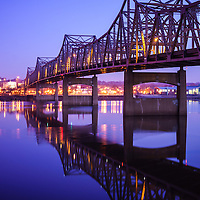 Peoria Illinois Bridge at Night - Murray Baker Bridge. The Murray Baker Bridge spans the Illinois River connecting Peoria with East Peoria as Interstate I-74. Built in 1958, the bridge is named after Murray Baker who started a company that would later become Caterpillar.