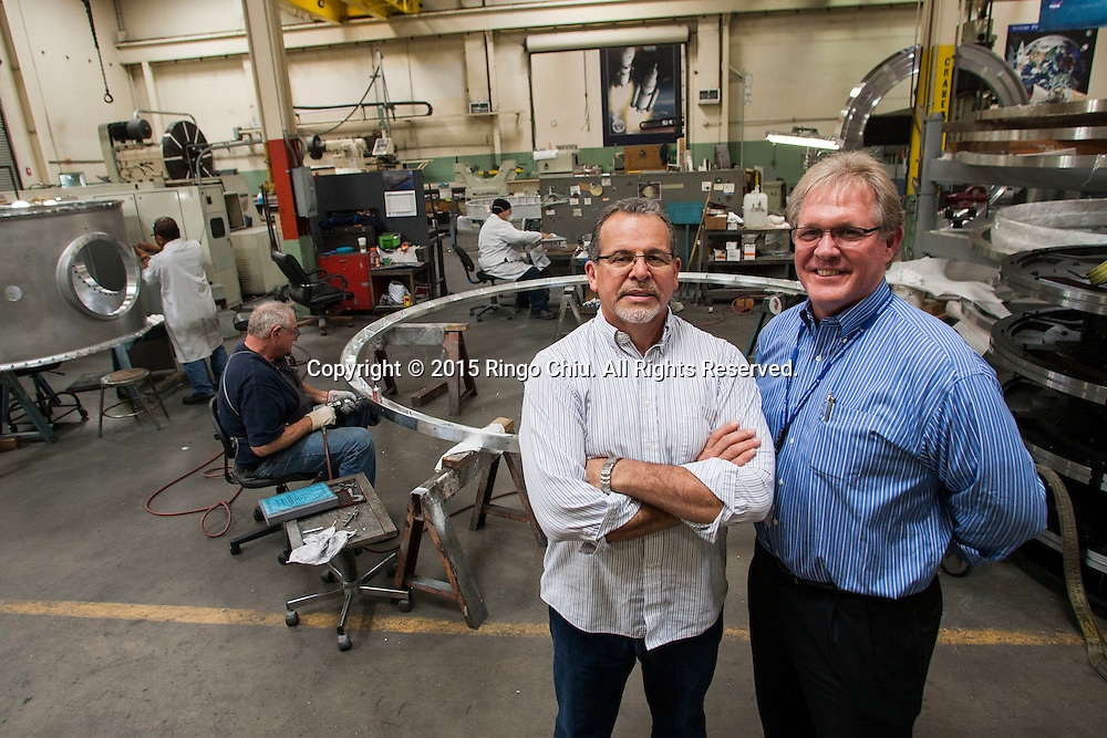 Tim Gervais, right, vice president of business development, and Art Talavera, vice president of operations, for Votaw Precision Technologies, Inc. (Photo by Ringo Chiu/PHOTOFORMULA.com)