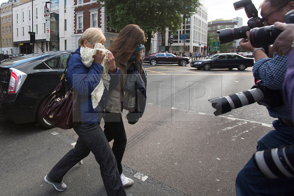 © licensed to London News Pictures. London, UK 09/08/2013. Photographers taking pictures of Domenico Rancadore's wife Anne Rancadore (left) and daughter Daniela Skinner (left) leaving Westminster Magistrates' Court in London on Friday, August 09, 2013. Photo credit: Tolga Akmen/LNP