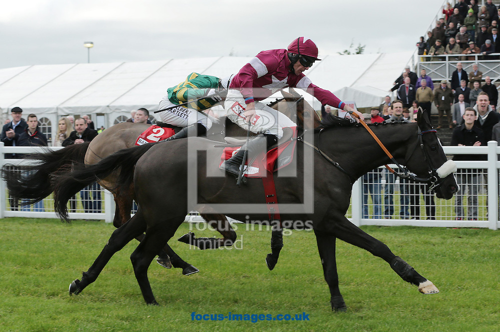 Picture by Lorraine O'Sullivan/Focus Images Ltd +353 872341234<br /> 01/12/2013<br /> Davy Russell on Don Cossack wins the Bar One Racing Drinmore Novice Steeplechase from Tony McCoy on Carlingford Lough Fairyhouse Races at Fairyhouse Racecourse, Ratoath.