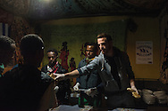 Antoine (30), graphic designer, born in Africa from a Belgian Congolese family,  is a volunteer. In this picture Antoine is seen during the dinner distribution at the Baobab Center.