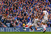 Rangers Captain James Tavernier (C) of Rangers FC crosses the ball under pressure from Max Lowe of Aberdeen FC during the Ladbrokes Scottish Premiership match between Rangers and Aberdeen at Ibrox, Glasgow, Scotland on 27 April 2019.