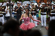 A high school girl dances during a parade celebrating El Salvador's independence day in San Isidro, Cabañas. Pacific Rim's controversial El Dorado gold mine has been the focus of numerous social conflicts at local and national level. Three anti-mining local leaders were murdered in 2009. While a year before, former president Antonio Saca refused to authorize the company's mining permit. This action prompted Pacific Rim to invoked a provision of the Central American Free Trade Agreement (CAFTA) to place the matter in the hands of an international arbitration court. Oceana Gold, who took over Pacific Rim on October 2013 for US $10.2 million , now seeks US $300 million for damages agains the State of El Salvador. San Isidro, Cabañas, El Salvador. September 15, 2014.