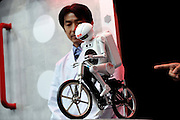 Seisaku-kun, a cycling humanoid robot from Murata Manufacturing Co., is demonstrated Japan.