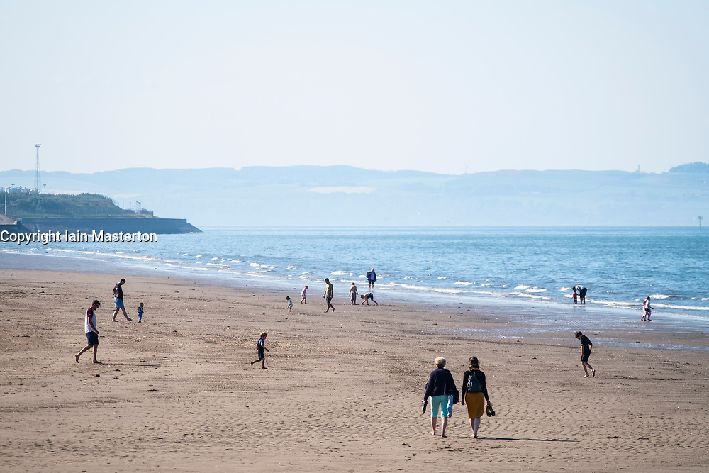 Portobello, Scotland, UK. 28 May, 2018. Sunny warm weather on a Bank Holiday Monday brought crowds to the beach at Portobello outside Edinburgh.
