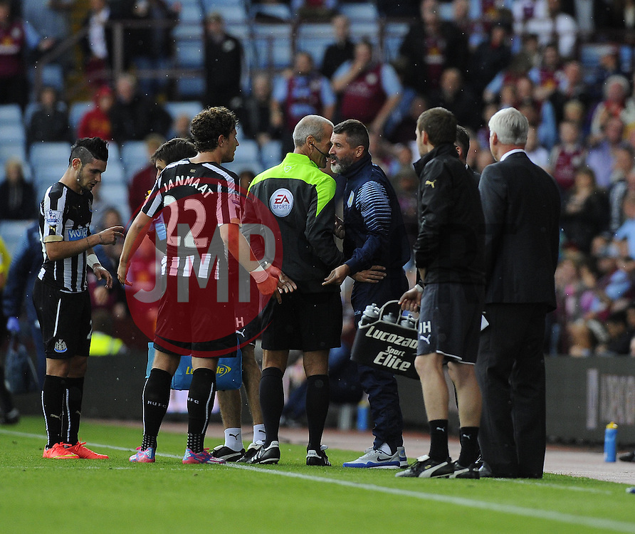 Aston Villa, Assistant Manager, Roy Keane confronts Newcastle United's Daryl Janmaat - Photo mandatory by-line: Joe Meredith/JMP - Mobile: 07966 386802 23/08/2014 - SPORT - FOOTBALL - Birmingham - Villa Park - Aston Villa v Newcastle United - Barclays Premier League