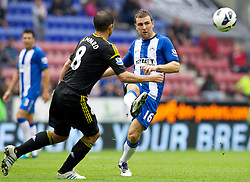 WIGAN, ENGLAND - Sunday, August 19, 2012: Wigan Athletic's James McArthur in action during the Premiership match against Chelsea at the DW Stadium. (Pic by Vegard Grott/Propaganda)