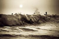 Riders catch last waves in evening at Magic Sands Beach, in Kona, HI.  Copyright 2009 Reid McNally.