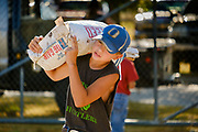 16 JULY 2020 - BOONE, IOWA: A 4H contestant carries a bag of feed to a barn at the country fairgrounds on the first day of the Boone County Fair in Boone. Summer is county fair season in Iowa. Most of Iowa's 99 counties host their county fairs before the Iowa State Fair. In 2020, because of the COVID-19 (Coronavirus) pandemic, many county fairs were cancelled, and most of the other county fairs were scaled back to concentrate on 4H livestock judging. Boone county scaled back its fair this year. The Iowa State Fair was cancelled completely. Boone County Emergency Management did not approve going ahead with the fair, and has advised anyone who goes to the fair to take precautions and monitor themselves for symptoms of the Coronavirus.           PHOTO BY JACK KURTZ