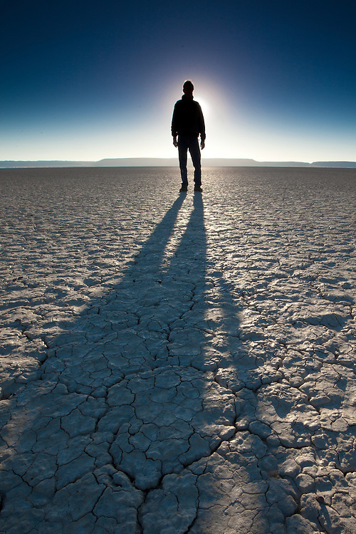A man stands silhouetted against the rising sun on the Alvord Desert in southern Oregon
