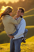 Happy couple in a grassy field people ****Model Release available