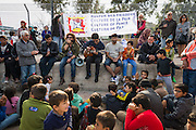 LESVOS, GREECE - NOV 6: Refugees gather to commemorate the thousands of people who drowned in the Aegean Sea while trying to reach the safety of European shores in Mytilene on November 6th, 2016. As part of an event organised by German organisation 'Culture of Peace', Afghan musicians Shekib Mosadeq and Masoud Hasnazada perform during the ceremony.