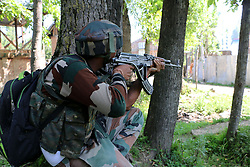 July 2, 2017 - Pulwama, Jammu & Kashmir, India - An Indian army soldier stands alert near the encounter at Bamnoo area of South Kashmir's Pulwama, Indian controlled Kashmir on 2 July 2017, Two Hizb Rebels  killed after encounter raged between government forces and suspected Rebels. (Credit Image: © Muneeb Ul Islam/Pacific Press via ZUMA Wire)