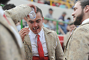 BEA AHBECK/NEWS-SENTINEL<br /> Amadores Luso Americanos de Turlock's Ulysses Gutierrez gets help cleaning blood off his face after grabbing his second bull of the year during the bloodless bullfight during the Our Lady of Fatima Portuguese Festival in Thornton Saturday, Oct. 15, 2016.