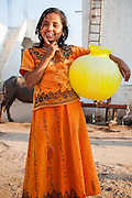 Girl with water plastic container (India)