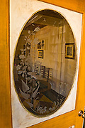 Etched glass door window and historic photographs, Harmony, California