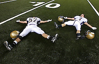 The Connell Eagles' Stefan Davidson, and Austin Huber, from left, celebrate capturing the 1A state championship title agasint Cascade Christian at the Tacoma Dome, December 3, 2011.(Janet Jensen/Staff photographer)