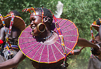 A girl from the Pokot tribe dances in northern Kenya.
