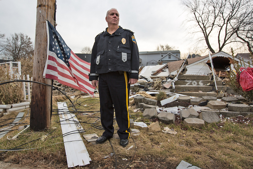 Union Beach NJ, November 16, Police Chief Scott Woolley in front of a church destroyed by superstorm Sandy's surge, that damaged over 200 homes in Union Beach alone. Hurricane Sandy's strength is being blamed on climate change by many scientists.