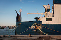"""TRAPANI, ITALY - 7 JUNE 2016: Cargo ship Aberdeen, seized by the Guardia di Finanza (Financial Police) in June 2014 as it was carrying 42 tons of hashish from Morocco to Libya, is docked here in the harbor in Trapani, Italy, on June 7th 2016.<br /> <br /> Between January 2014 e December 2015 more than 120 tons of hashish, carried on fishing boats or cargo ships from Morocco to Libya, were seized in the Strait of Sicily by Italy's Guardia di Finanza (Financial Police) thanks to an international police investigation named """"Operazione Libeccio"""", carried out by the GICO (Gruppo Investigativo Criminalità Organizzata, Organised Crime Investigation Group), a unit of the tax police of Palermo under the supervision of the DDA (Direzione Distrettuale Antimafia) of Palermo.<br /> <br /> """"What is happening in Libya is same historical occurrence that happened years ago in Afghanistan. Such as the Talibans who financed their terroristic activities with heroin trafficking for the purchase of weapons, the Caliphate is proposing the same terroristic strategy by purchasing and commercialising hashish in order to purchase weapons used in their war"""" Sergio Barbera, Deputy General Prosecutor of Palermo, said."""