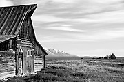 Mormon barn with Northern Teton range in the backgound.  Shot early morning, Teton National Forest, WY.  Just North of Jackson
