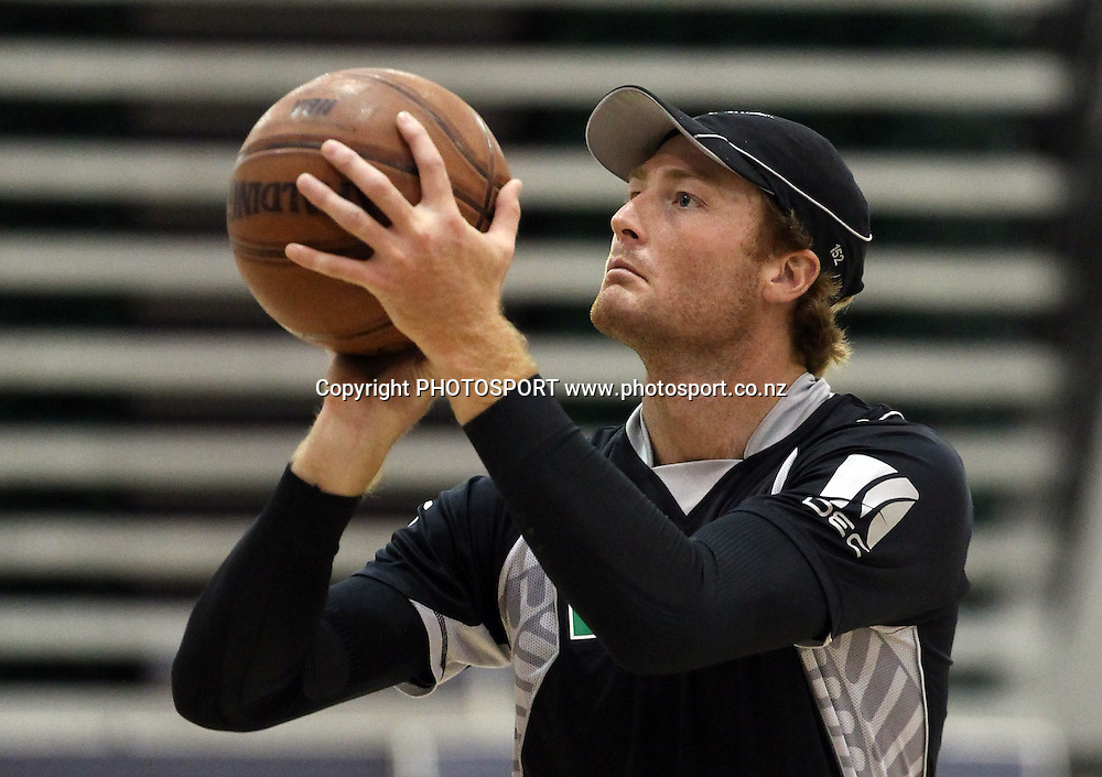 Martin Guptill plays basketball indoors at the Queenstown Events Centre as the rain continues to stop play. 2nd ODI, Black Caps v Pakistan, One Day International Cricket. Queenstown, New Zealand. Wednesday 26  January 2011. Photo: Andrew Cornaga/photosport.co.nz