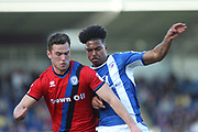 Harrison McGahey challenged by Rai Simons during the EFL Sky Bet League 1 match between Chesterfield and Rochdale at the b2net stadium, Chesterfield, England on 25 March 2017. Photo by Daniel Youngs.