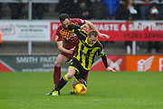 Burton Albion forward Stuart Beavon and Bradford City defender Rory McArdle challenge for the ball during the Sky Bet League 1 match between Burton Albion and Bradford City at the Pirelli Stadium, Burton upon Trent, England on 6 February 2016. Photo by Aaron Lupton.