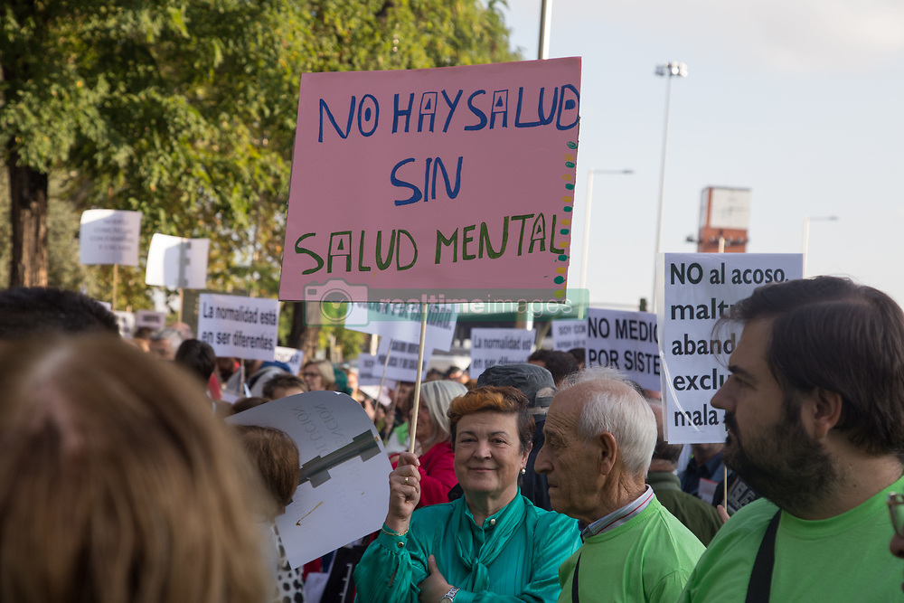 October 10, 2018 - Madrid, Spain - Protester seen holding a poster written there is no health without mental health during the protest..Hundreds of people have protested from Atocha to Puerta Del Sol against the labels that society puts on them on the International Mental Health Day where the Spanish public health system has demanded for an improvement in the matters of Mental Health, the public health system has also criticized the budget cuts in the Mental Health. (Credit Image: © Lito Lizana/SOPA Images via ZUMA Wire)