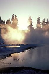 WY: Wyoming; Yellowstone National Park, dawn, mist from hot springs geysers            .Photo Copyright Lee Foster, lee@fostertravel.com, www.fostertravel.com, (510) 549-2202.Image: wyyell209