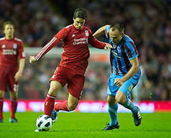 LIVERPOOL, ENGLAND - Thursday, August 19, 2010: Liverpool's Fernando Torres and Trabzonspor's Arkadiusz Glowacki during the UEFA Europa League Play-Off 1st Leg match at Anfield. (Pic by: David Rawcliffe/Propaganda)