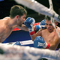 Puerto Rican Olymian Jeyvier Cintron (L) lands a shot the head of  Edson Noria during a Telemundo boxing match between at Osceola Heritage Park on Friday, February 23, 2018 in Kissimmee, Florida.  (Alex Menendez via AP)