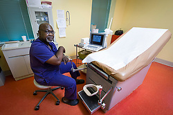 Dr. Willie Parker, sits in the room where he performs abortions at the Jackson Women's Health Organization, on Monday August 18, 2014, in Jackson, Mississippi. Parker is one of two doctors, both who travel from out of state, to offer their services at the last abortion clinic in Mississippi. (Photo © Jock Fistick)