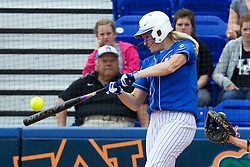 UK first baseman Lauren Cumbess hits a two run home run in the 1st inning. The University of Kentucky Softball team hosted Virginia Tech in KY Regional Game 3 of the NCAA D1 Softball Championship, Saturday, May 18, 2013 at John Cropp Stadium in Lexington. Photo by Jonathan Palmer