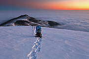 Snowy mountain ridge above the clouds