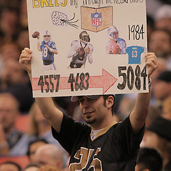 2008 December, 28: A New Orleans Saints fans holds up a sign during a week 17 game between NFC South divisional rivals the Carolina Panthers and the New Orleans Saints at the Louisiana Superdome in New Orleans, LA.  New Orleans Saints quarterback Drew Brees fell 16-yards short of the NFL record for passing yardage in a season.