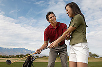 Woman Getting a Golf Lesson