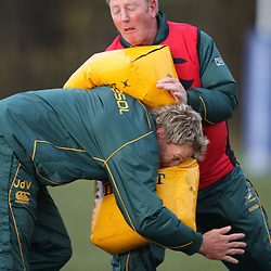 EDINBURGH, SCOTLAND - NOVEMBER 18, Dick Muir assistant coach on the bag with Jean de Villiers during the South African rugby team field training session and team announcement at Peffermill Sports Complex on November 18, 2010 in Edinburgh, Scotland<br /> Photo by Steve Haag / Gallo Images