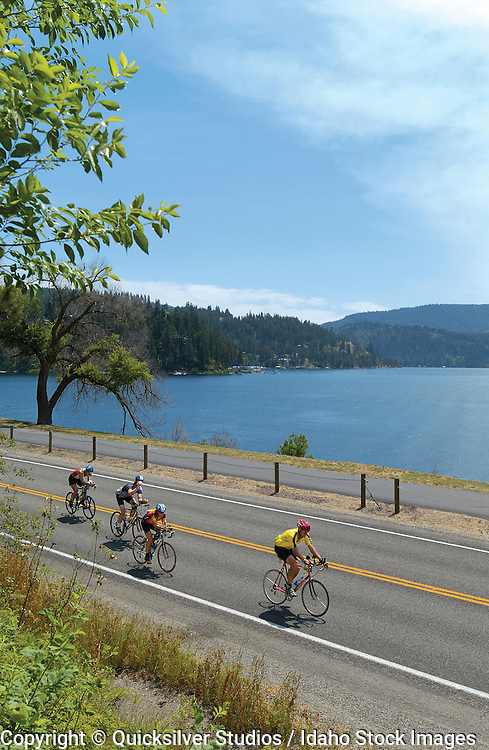Athletes biking along Coeur d' Alene Lake, northern Idaho.