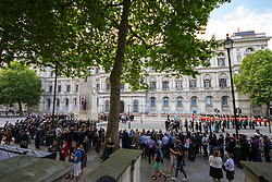 Whitehall, London, May 24th 2017.  Wreaths are laid at the Cenotaph on Whitehall in London as The Band of the Welsh Guards and the Colour Guard of the United Nations Veterans Association lead members of the diplomatic corps and wreath layers from The Royal United Services Institute as they observe The International day of United Nations Peacekeepers, amid tight security. PICTURED: A wide view of the wreath laying ceremony in Whitehall.