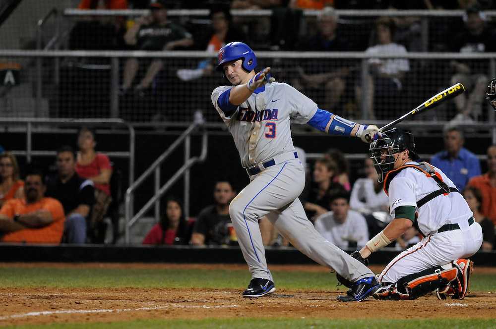 March 2, 2012: Mike Zunino #3 of Florida in action during the game between the Miami Hurricanes and Florida Gators at Alex Rodriguez Park in Coral Gables, FL. The Gators defeated the Hurricanes 7-5.