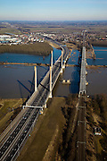 Nederland, Gelderland, Zaltbommel, 07-03-2010; bruggen over de rivier de Waal, gezien naar de Tielerwaardwaard met Waardenburg in de achtergrond Rechts de spoorburg (spoorlijn Utrecht - Den Bosch), links de Martinus Nijhofbrug (rijksweg A2 richting Utrecht, aan de horizon). De oude brug voor autoverkeer is gesloopt (pijler nog in de rivier)..Bridges over the River Waal, in the direction of the Tilerwaard. Right the railway bridge (railway line Utrecht - Den Bosch), left the Martinus Nijhof bridge right (A2). The old traffic bridge has been demolished (pillar still in the river)..luchtfoto (toeslag), aerial photo (additional fee required).foto/photo Siebe Swart